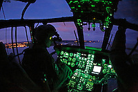 Pilot in check out training, Erik Hals, flying with night vision goggles. Crew from Norwegian Air Force 330 squadron, flying Westland Sea King helicopter. The core mission of the squadron is SAR (search and rescue), but they also fly HEMS (Helicopter Emergency Medical Service), complementing the civilian air ambulance service.<br />