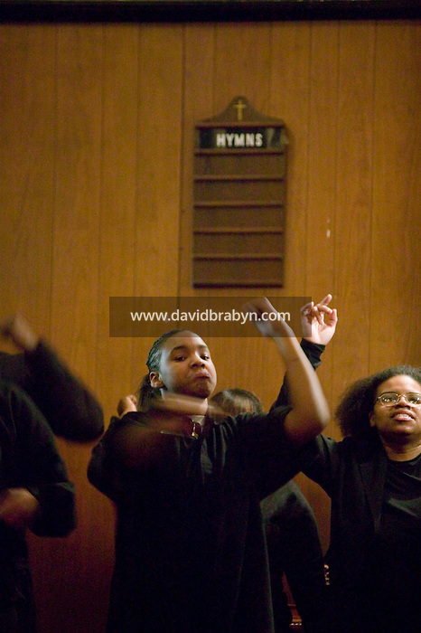 New York, USA - Hip-Hop Choir members perform during mass at the Greater Hood Memorial AME Zion Church, home of the Hip-Hop Church, in Harlem, New York, USA, 3 February 2005. Photo Credit: David Brabyn.