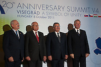 Presidents of Visegrad countries (V4), (L-R) Ivan Gasparovic of Slovakia, Vaclav Klaus of Czech Republic, Bronislaw Komorowski of Poland and Pal Schmitt of Hungary pose for photographers during their summit in Visegrad, 55 km (34.2 miles) north of Visegrad, Hungary on October 08, 2011. ATTILA VOLGYI