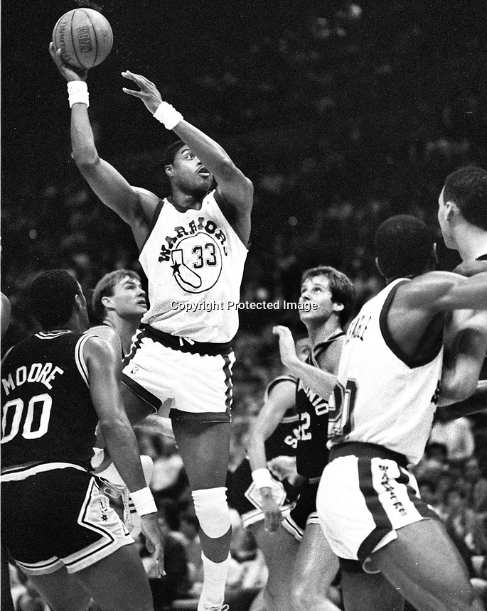 Golden State Warriors Jerome Whitehead #33 up for shot against San Antonio Spurs..(1987 photo/Ron Riesterer)
