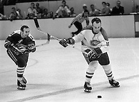 Seals Gary Jarrett tries to block shot of Montreal Canadiens Henri Richard..(1970 photo/Ron Riesterer)