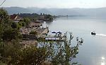 Tushemisht-Pogradec-Albania - August 02, 2004---Beach and tourists at Lake Ohrid; region/village of project implementation by GTZ-Wiram-Albania (German Technical Cooperation, Deutsche Gesellschaft fuer Technische Zusammenarbeit (GTZ) GmbH); environment-landscape-tourism---Photo: Horst Wagner/eup-images