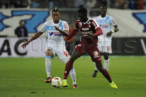 16.10.2016. Marseille, France. French league 1 football. Olympique Marseille versus Metz.  Njie (OM) challenges Sarr (Metz)