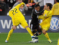 DC United midfielder Andy Najar (14) gets fouled by Columbus Crew defender Sebastian Miranda (21) right and Dejar Rusmir (22) left   DC United defeated The Columbus Crew 3-1  at the home season opener, at RFK Stadium, Saturday March 19, 2011.