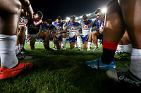 Both teams huddle for the end of game prayer. Sydney Roosters v Vodafone Warriors, NRL Rugby League. Allianz Stadium, Sydney, Australia. 31st March 2018. Copyright Photo: David Neilson / www.photosport.nz