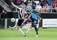 Adebayo Akinfenwa of Wycombe Wanderers and Charlie Wassmer of Maidenhead United during the Friendly match between Maidenhead United and Wycombe Wanderers at York Road, Maidenhead, England on 30 July 2016. Photo by Alan  Stanford PRiME Media Images.