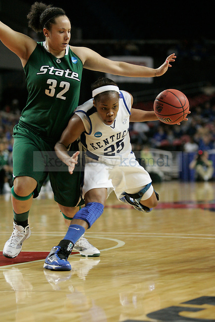UK's Amani Franklin drives against Michigan State's Kalisha Keane at Freedom Hall on Monday, March 22, 2010. Photo by Scott Hannigan | Staff