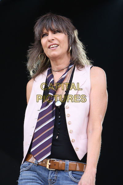 THE PRETENDERS - Chrissie Hynde.Perform during Hard Rock Calling 2009, Hyde Park, London, England, UK,27th June 2009..music concert gig on stage live festival .half length black top white waistcoat striped stripes tie purple.CAP/MAR.©Martin Harris/Capital Pictures