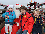 Anna, Andrew and Eoin Darcy pictured with santa when he visited Julianstown Community Gardens. Photo:Colin Bell/pressphotos.ie