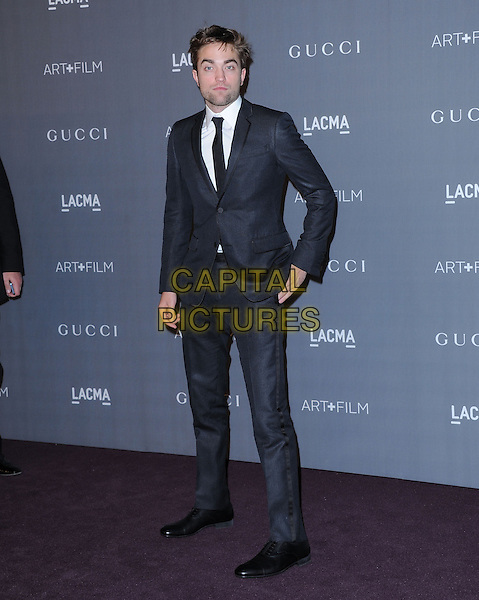 Robert Pattinson.at The LACMA 2012 Art and Film Gala held at LACMA in Los Angeles, California, USA, October 27th 2012..full length black suit hand grey gray tie white shirt beard facial hair .CAP/RKE/DVS.©DVS/RockinExposures/Capital Pictures.