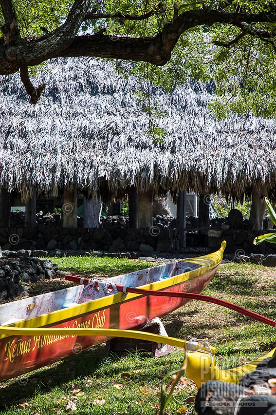 Hawaiian outrigger canoes and a thatched canoe house at Keoua Honaunau Canoe Club, Honaunau, Big Island.