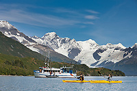 M/V Discovery and kayakers, Harriman Fjord, Mt Gilbert,  Chugach mountains, Chugach National Forest, Prince William Sound, southcentral, Alaska.
