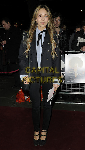 ZARA MARTIN.Press night for 'The Hurly Burly Show' at the Garrick Theatre, London, England, March 11th 2011..full length black jeans jacket blazer tie bow shirt ty mary janes shoes navy blue bag .CAP/CAN.©Can Nguyen/Capital Pictures.