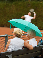 2013,August 21,Netherlands, Amstelveen,  TV de Kegel, Tennis, NVK 2013, National Veterans Tennis Championships,  under the parasol <br /> Photo: Henk Koster