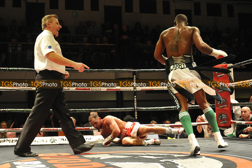 Larry Ekundayo (black/white shorts) defeats Dale Evans - Boxing at York Hall, Bethnal Green, London - 14/03/15 - MANDATORY CREDIT: Philip Sharkey/TGSPHOTO - Self billing applies where appropriate - contact@tgsphoto.co.uk - NO UNPAID USE