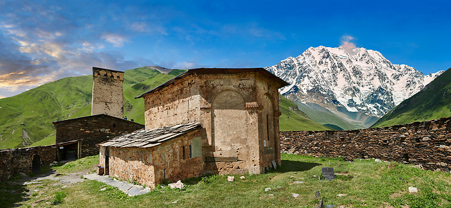 "The medieval Georgian Orthodox St George Church ""JGRag"" with mount Shkhara (5193m) behind, Ushguli, Upper Svaneti, Samegrelo-Zemo Svaneti, Mestia, Georgia. At 2,200 m (7217 ft) above sea level in the Caucasus mountains St George Church is one of  the highest in Europe. Mount Shkhara is the highest mountain in the Caucasus range."