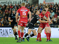 Scarlets' Hadleigh Parkes evades the tackle of Ospreys' Dan Biggar<br /> <br /> Photographer Ashley Crowden/CameraSport<br /> <br /> Guinness Pro14 Round 6 - Ospreys v Scarlets - Saturday 7th October 2017 - Liberty Stadium - Swansea<br /> <br /> World Copyright &copy; 2017 CameraSport. All rights reserved. 43 Linden Ave. Countesthorpe. Leicester. England. LE8 5PG - Tel: +44 (0) 116 277 4147 - admin@camerasport.com - www.camerasport.com