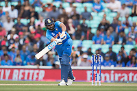 Rohit Sharma (India) clips in the air square of the wicket during India vs Australia, ICC World Cup Cricket at The Oval on 9th June 2019