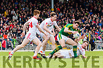 David Moran gets to the ball ahead ahead of four Tyrone defenders during their National League clash in Fitzgerald Stadium on Sunday