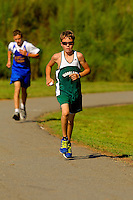 Photography of middle school sports - cross country meet. Boy is sun glasses is model released.