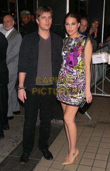 "ROB & MARISOL THOMAS.The Premiere of ""Solitary Man"" at Cinema 2, New York, NY, USA..May 11th, 2010.full length sleeveless dress pink purple green beige pointy shoes black clutch bag pattern print married husband wife black suit grey gray top.CAP/LNC/TOM.©TOM/LNC/Capital Pictures."