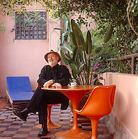 Proprietor and collector Jean Luc Lemee sits at a Saarinen table in one of Riad Malika's courtyards