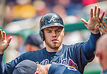 22 June 2014: Atlanta Braves first baseman Freddie Freeman returns to the dugout after scoring a run against the Washington Nationals at Nationals Park in Washington, DC. The Nationals defeated the Braves 4-1 to split their 4-game series and take sole possession of first place in the NL East. Mandatory Credit: Ed Wolfstein Photo *** RAW (NEF) Image File Available ***
