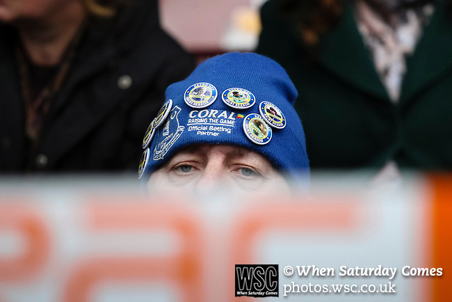 Liverpool Ladies 2 Everton Ladies 1, 19/03/2017. Select Security Stadium, SSE FA Cup Fifth Round. An Everton fan looking over the dug outs during the game between Liverpool Ladies v Everton Ladies at The Select Security Stadium, Widnes, in the Women's SSE FA Cup Fifth Round. Photo by Paul Thompson.