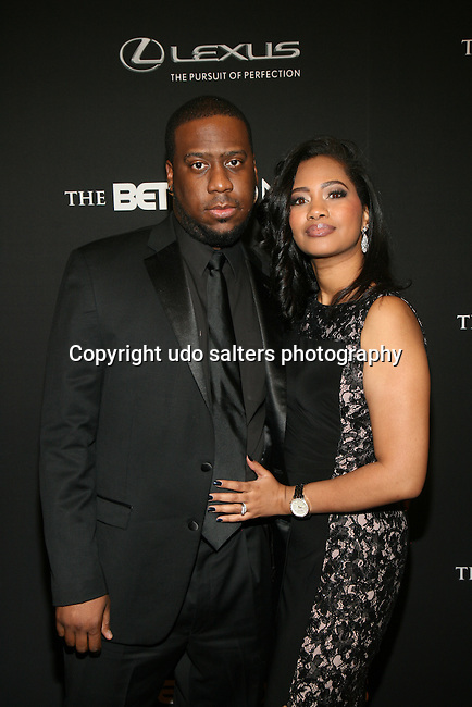 Jazz Musician Robert Glasper and Writer Angelika Beener Attend BET Honors 2014 Honoring The Queen of Soul, Aretha Franklin, Motown Records Founder and Creator of the MOTOWN THE MUSICAL, Berry Gordy, American Express CEO & Chairman, Ken Chenault,Visual Artist Carrie Mae Weems and Entertainment Trailblazer Ice Cube. Hosted by Actor and Comedian, Wayne Brady Held at Warner Theater in Washington, D.C.
