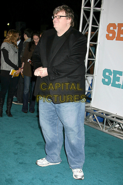 "MICHAEL MOORE.""Semi-Pro"" Los Angeles Premiere held at Mann's Village Theatre, Westwood, California, USA..February 19th, 2008.full length jeans denim black suit jacket glasses .CAP/ADM/RE.©Russ Elliot/AdMedia/Capital Pictures."