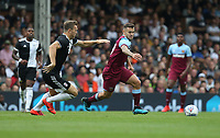 West Ham United's Jack Wilshere and Fulham's Kevin McDonald<br /> <br /> Photographer Rob Newell/CameraSport<br /> <br /> Football Pre-Season Friendly - Fulham v West Ham United - Saturday July 27th 2019 - Craven Cottage - London<br /> <br /> World Copyright © 2019 CameraSport. All rights reserved. 43 Linden Ave. Countesthorpe. Leicester. England. LE8 5PG - Tel: +44 (0) 116 277 4147 - admin@camerasport.com - www.camerasport.com