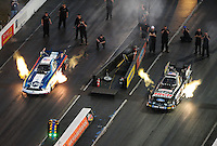 Jan. 20, 2012; Jupiter, FL, USA: Aerial view of NHRA funny car driver John Force (right) races alongside Tim Wilkerson during testing at the PRO Winter Warmup at Palm Beach International Raceway. Mandatory Credit: Mark J. Rebilas-