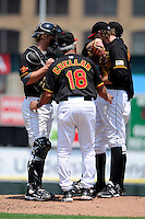 Rochester Red Wings pitching coach Bobby Cuellar #18 talks with pitcher Matt Maloney #17 (right) and catcher J.R. Towles #5 during a game against the Durham Bulls at Frontier Field on June 21, 2012 in Rochester, New York.  Durham defeated Rochester 14-8.  (Mike Janes/Four Seam Images)