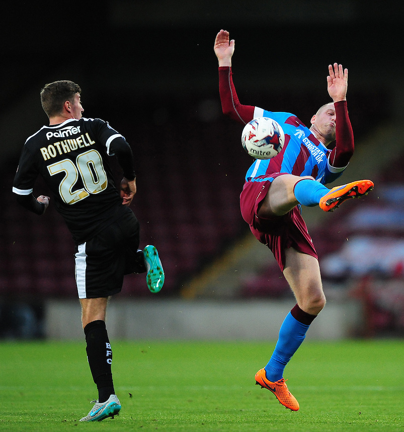Scunthorpe United's Neil Bishop, right, vies for possession with Barnsley's Joe Rothwell<br /> <br /> Photographer Chris Vaughan/CameraSport<br /> <br /> Football - Capital One Cup First Round - Scunthorpe United v Barnsley - Tuesday 11th August 2015 - Glanford Park - Scunthorpe<br />  <br /> &copy; CameraSport - 43 Linden Ave. Countesthorpe. Leicester. England. LE8 5PG - Tel: +44 (0) 116 277 4147 - admin@camerasport.com - www.camerasport.com