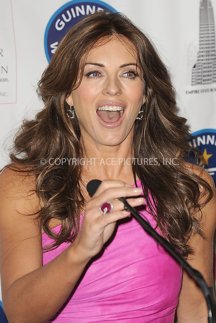 WWW.ACEPIXS.COM . . . . . . October 1, 2010, New York City.... Elizabeth Hurley illuminates the iconic peak of the Empire State Building in pink as part of a global Guinness World Records attempt by The Estee Lauder Companies in honor of Breast Cancer Awareness Month on October 1, 2010 in New York City....Please byline: KRISTIN CALLAHAN - ACEPIXS.COM.. . . . . . ..Ace Pictures, Inc: ..tel: (212) 243 8787 or (646) 769 0430..e-mail: info@acepixs.com..web: http://www.acepixs.com .