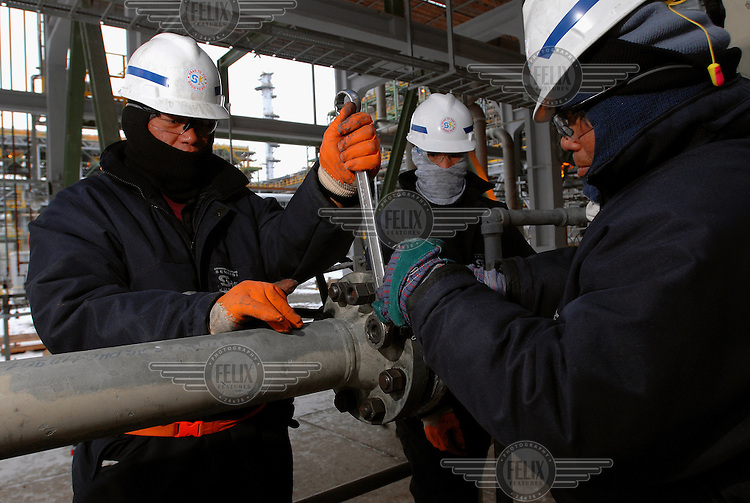 Foreign workers at an American oil/gas production and refinery complex on the edge of the Caspian Sea.