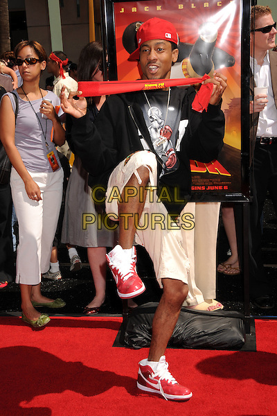 "BRANDON T. JACKSON.""Kung Fu Panda"" Los Angeles Premiere at Grauman's Chinese Theatre, Hollywood, California, USA..June 1st, 2008.full length black jumper beige short red trainers sneakers baseball cap hat posing leg up kick kicking scarf .CAP/ADM/BP.©Byron Purvis/AdMedia/Capital Pictures."