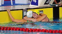 Wales' Georgia Davies, left, who finished second, in the women's 100m backstroke final hugs race winner Australia's Emily Seebohm<br /> <br /> Photographer Chris Vaughan/CameraSport<br /> <br /> 20th Commonwealth Games - Day 3 - Saturday 26th July 2014 - Swimming - Tollcross International Swimming Centre - Glasgow - UK<br /> <br /> © CameraSport - 43 Linden Ave. Countesthorpe. Leicester. England. LE8 5PG - Tel: +44 (0) 116 277 4147 - admin@camerasport.com - www.camerasport.com