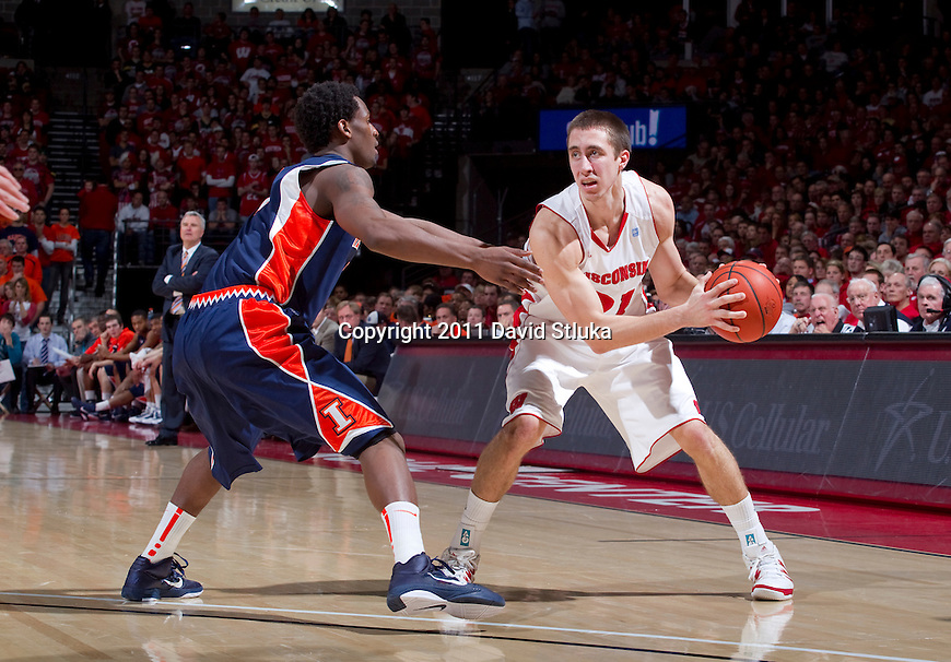 Wisconsin Badgers guard Josh Gasser (21) handles the ball during a Big Ten Conference NCAA college basketball game against the Illinois Fighting Illini at the Kohl Center in Madison, Wisconsin on January 15, 2011. Wisconsin won 76-66. (Photo by David Stluka)