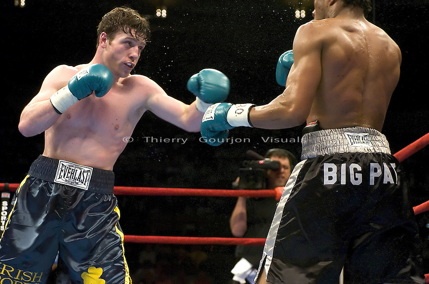 John Duddy (yellow stripe) and  Patrick Thompson during their  8 rounds Middleweight  fight at Madison Garden in NYC on 06.11.05. Duddy won by Unanimous decision.