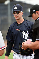 GCL Yankees 1 manager Travis Chapman (51) during the lineup exchange before the second game of a doubleheader against the GCL Braves on July 1, 2014 at the Yankees Minor League Complex in Tampa, Florida.  GCL Braves defeated the GCL Yankees 1 by a score of 3-1.  (Mike Janes/Four Seam Images)