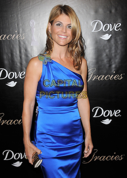 LORI LOUGHLIN.The Gracie Awards Gala held at The Beverly Hilton Hotel in Beverly Hills, California, USA..May 25th, 2010           .half length blue one shoulder silk satin dress silver brooch clutch bag .CAP/RKE/DVS.©DVS/RockinExposures/Capital Pictures.