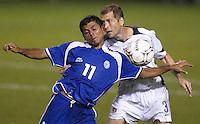 Ronald Cerritos, left, and Greg Berhalter, battle for a head ball in San Salvador, El Salvador, Saturday Oct. 9, 2004. USA won 2-0.