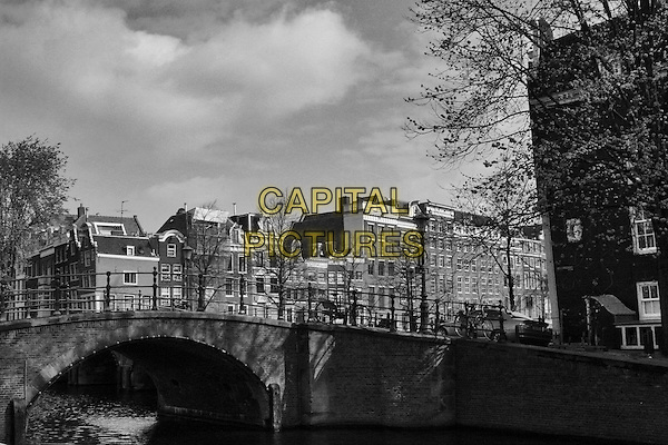 AMSTERDAM.travel canal water house homes black white bridge  .CAP/JOZ.©George Jozwiak/Capital Pictures.