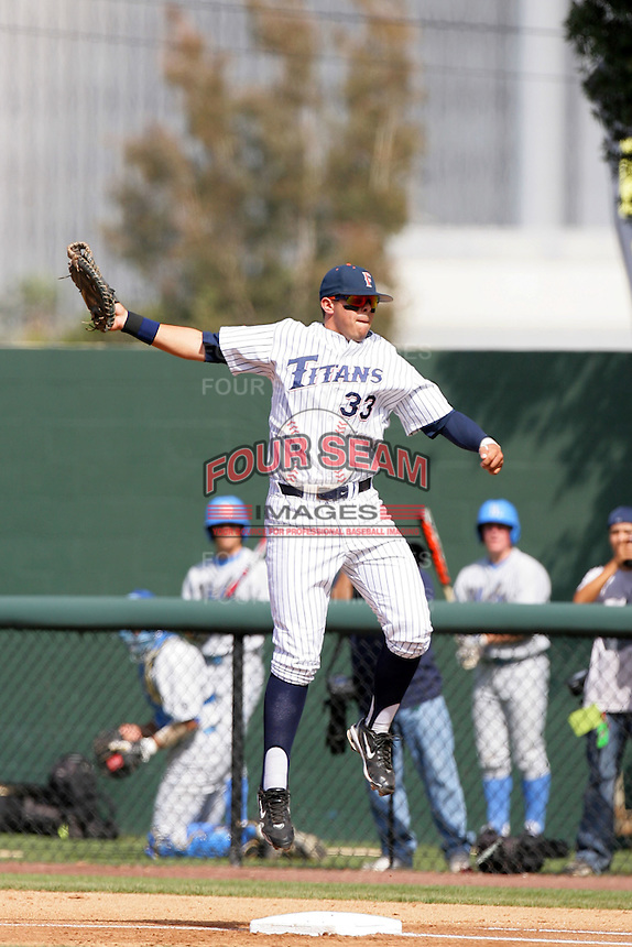 Nick Ramirez of the Cal.St. Fullerton Titans during game against the UCLA Bruins at Jackie Robinson Stadium in Los Angeles,California on June 12, 2010. Photo by Larry Goren/Four Seam Images