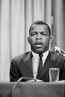 1964 Apr. 16. - John Lewis at a meeting of American Society of Newspaper Editors, bust portrait, seated at a table before a microphone.<br /> <br /> John Robert Lewis (born February 21, 1940) is an American politician and was a leader in the American Civil Rights Movement. He was chairman of the Student Nonviolent Coordinating Committee (SNCC) and played a key role in the struggle to end segregation. Lewis, a member of the Democratic Party, has represented Georgia's 5th Congressional District  in the United States House of Representatives since 1987. The district encompasses almost all of Atlanta.