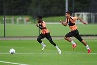 Nathan Dyer vies for possession with Kyle Naughton of Swansea City during the Swansea City Training Session at The Fairwood Training Ground, Wales, UK. Tuesday 11th September 2018
