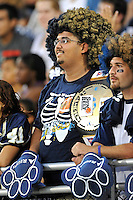 24 September 2011:  A fan cheers on the Golden Panthers as the University of Louisiana-Lafayette Ragin Cajuns defeated the FIU Golden Panthers, 36-31, at FIU Stadium in Miami, Florida.