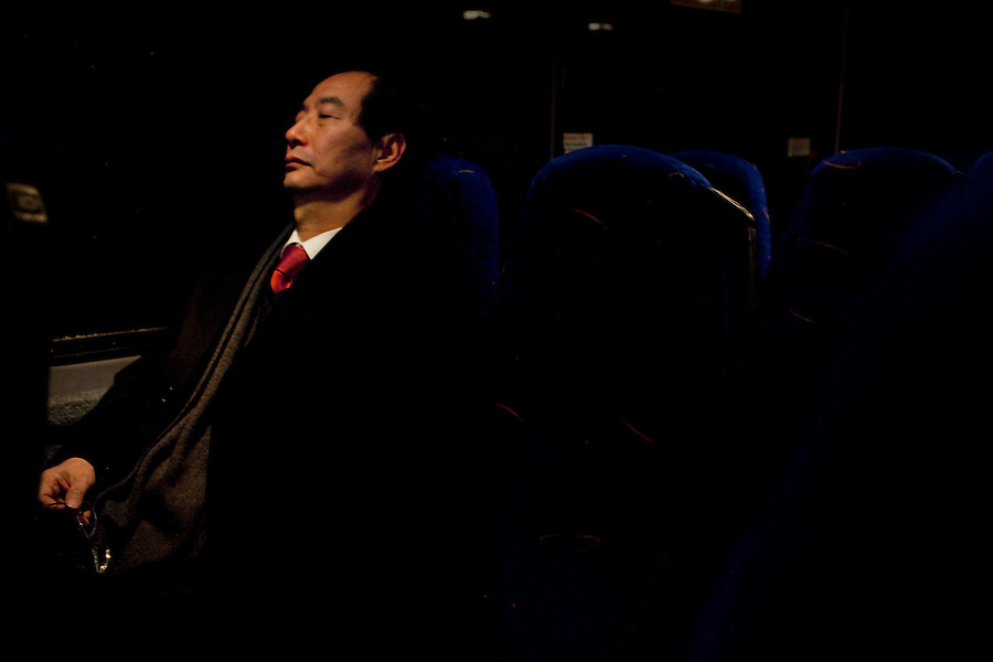 Los Angeles, California, January 24, 2011 - Han Duk-soo, South Korea's Ambassador to the United States takes a brief nap before arriving at the Wilshire Grand Hotel where Mr. Duk-soo will speak to reporters and host a dinner for local Korean-American business leaders. The delegation of Chamber of Commerce representatives and South Korean advisors was in town as part of a sustained effort since 2007 to sell the idea of the U.S.-Korea Free Trade Agreement to the US. Final language is still being worked out, but the agreement could come to a vote in the next few weeks. ..The U.S.-Korea Free Trade Agreement would eliminate tariffs on 95% of U.S. goods within five years of its signing and could boost U.S. exports by $11 billion annually, the International Trade Commission estimates. It would also reduce trade restrictions and tariffs on U.S. auto and beef exports while continuing American tariffs on South Korean autos for a limited time. Southern California would almost certainly be a major beneficiary. Nearly $16 billion in goods moved between South Korean and Southland ports in 2009. The Los Angeles area is home to an estimated 600,000 Korean Americans, many of whom have strong business ties to their homeland and are heavily invested in the local economy. Southern California's entertainment industry also supports the pact, which would clamp down on unauthorized copying and sharing of music and videos in South Korea, where piracy is a serious problem. ..