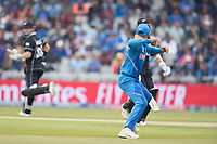 Virat Kolli (India) turns and throws as the New Zealand batsmen complete two during India vs New Zealand, ICC World Cup Semi-Final Cricket at Old Trafford on 9th July 2019